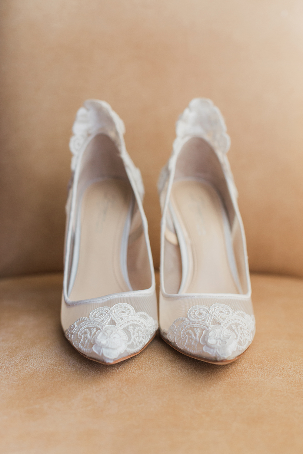 Nancy's white lace wedding shoes.