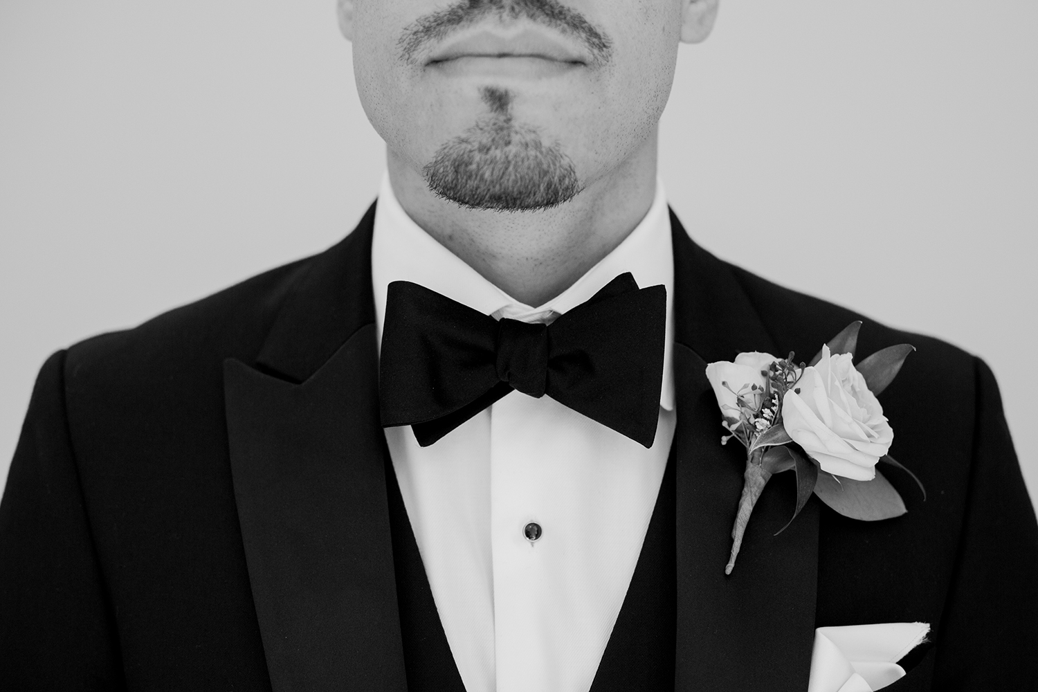 Suit, bowtie, and groom before walking down the aisle.