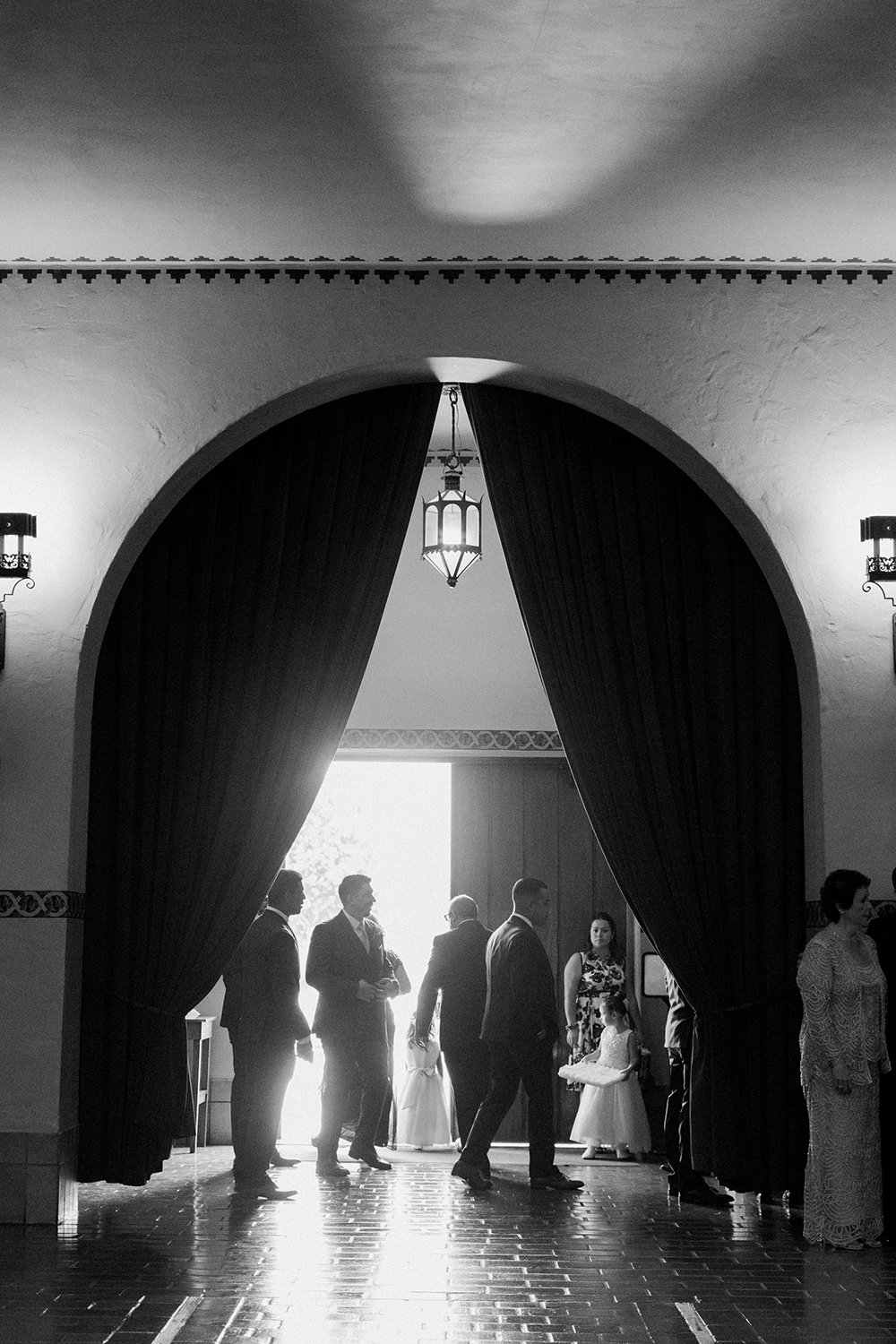 Family and guests lining up for the wedding ceremony to begin inside Mission Santa Clara de Asís.