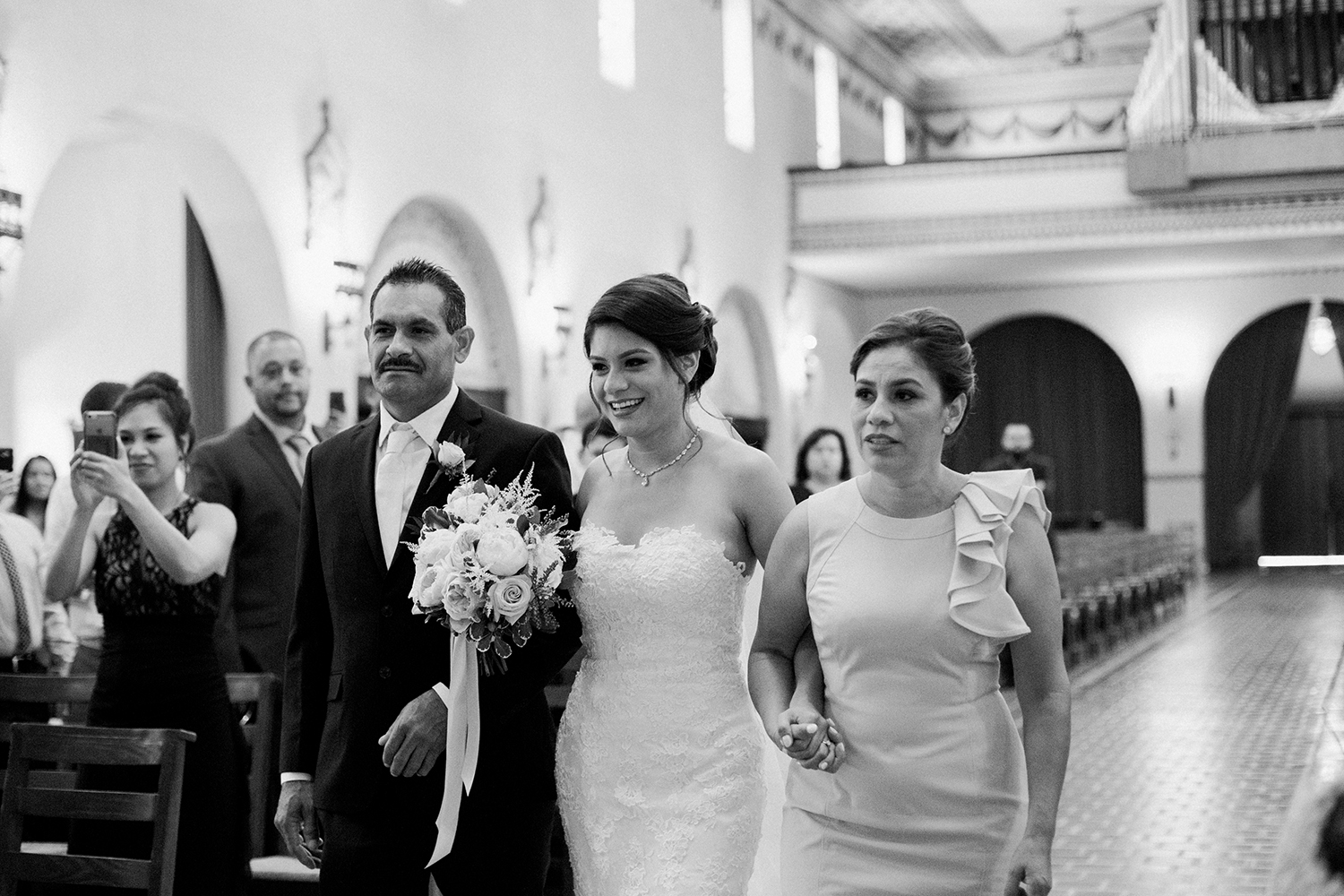 A modern bride walking down the aisle during her church wedding in Mission Santa Clara de Asís.