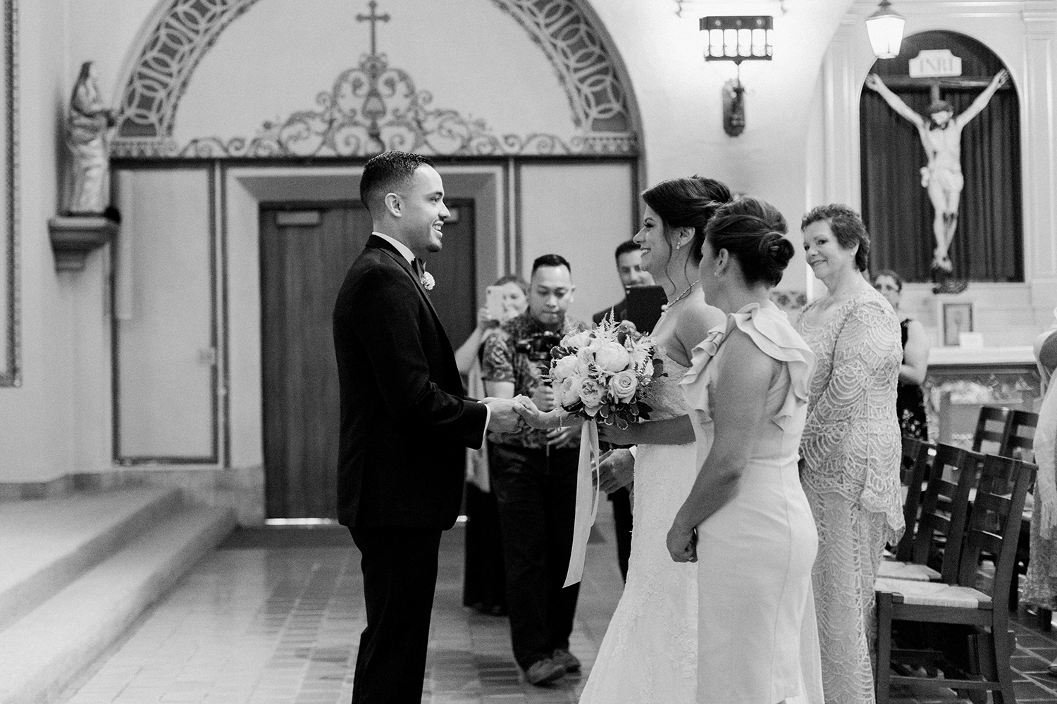 Groom taking his bride to the alter during their wedding in Mission Santa Clara de Asís.