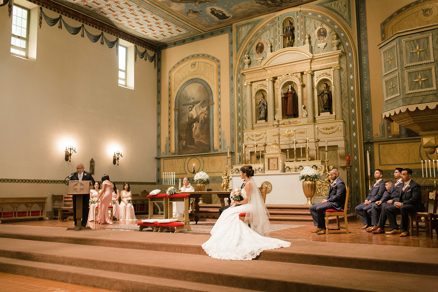 Wide view of the alter during a wedding ceremony in Mission Santa Clara de Asís.