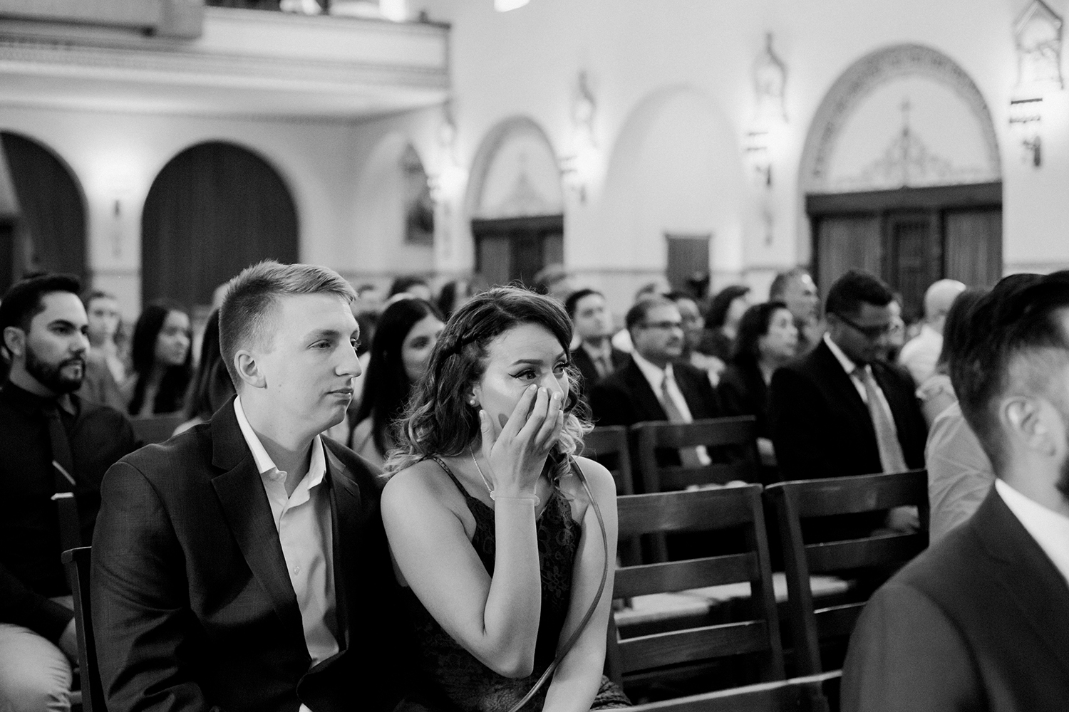 Guest wiping her tears during a wedding ceremony in Mission Santa Clara de Asis.