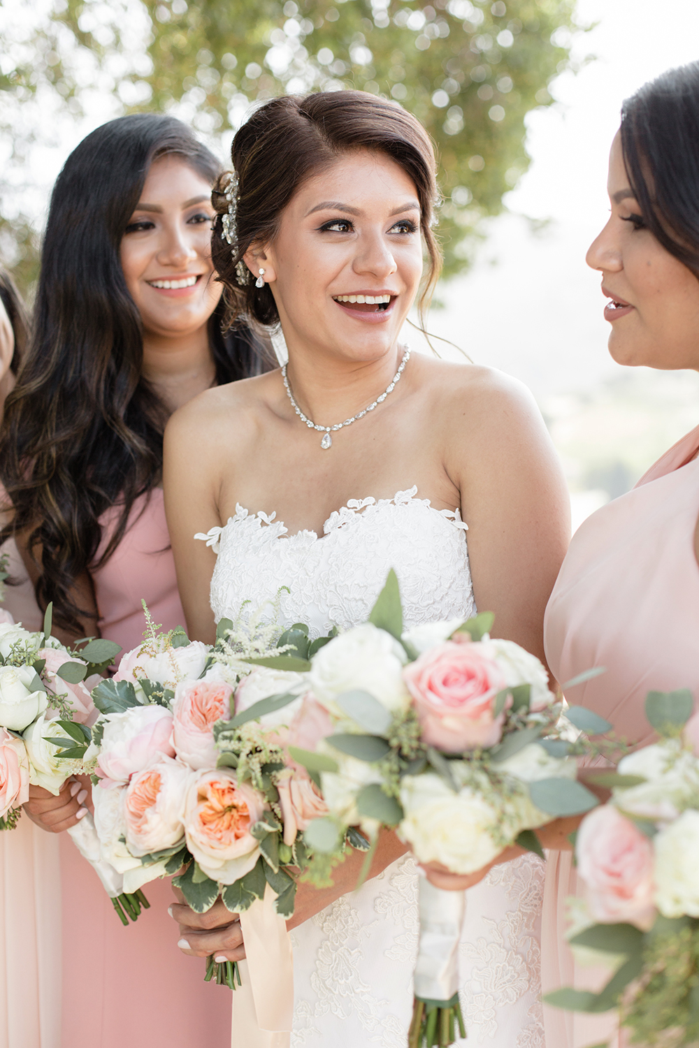 Modern bride with her bridesmaids.