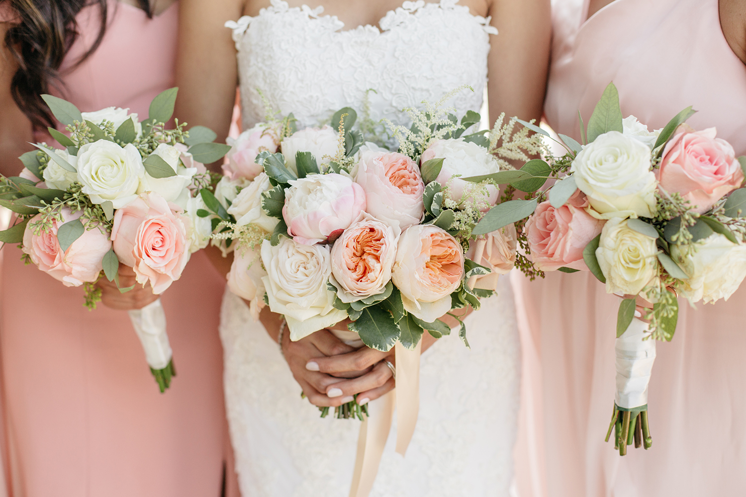 Bridedmaids and bride blush rose floral bouquets. Mission Santa Clara wedding.