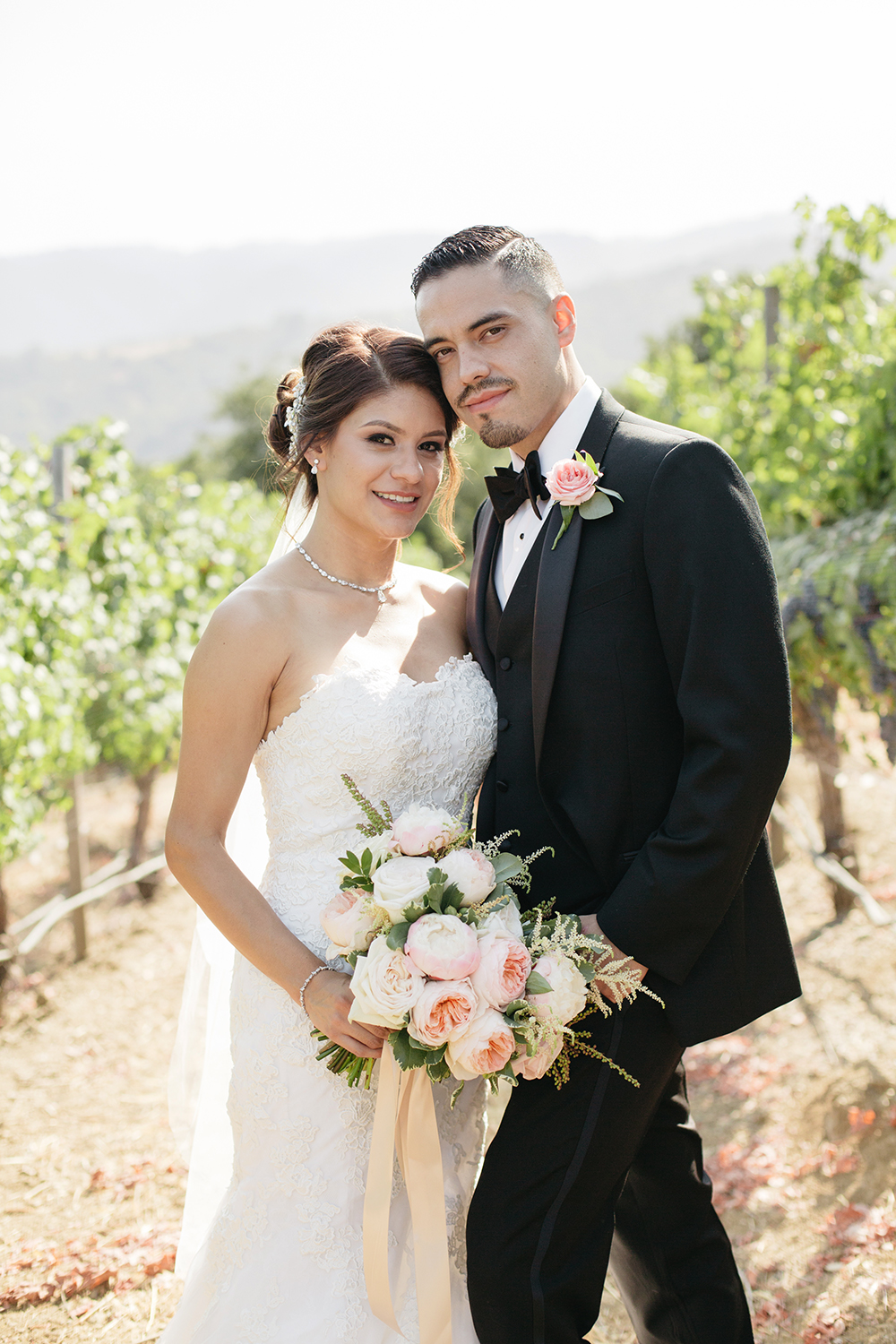 Modern bride and groom at their vineyard wedding in Saratoga, California.