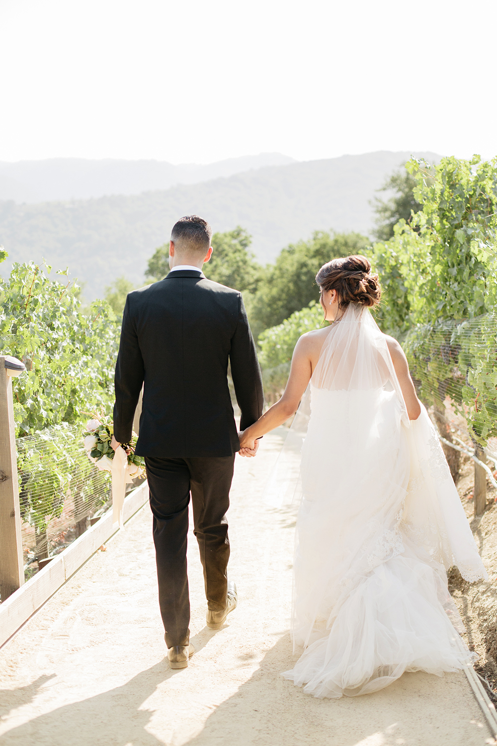 Bride and groom walking hand in hand to their wedding in Saratoga, California.