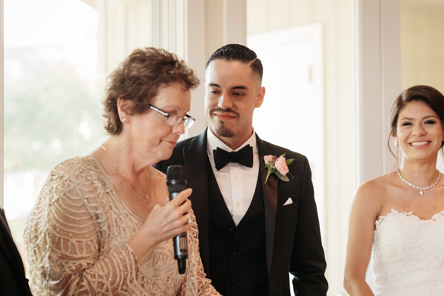 Groom's mother giving a speech at his wedding in Saratoga Country Club.