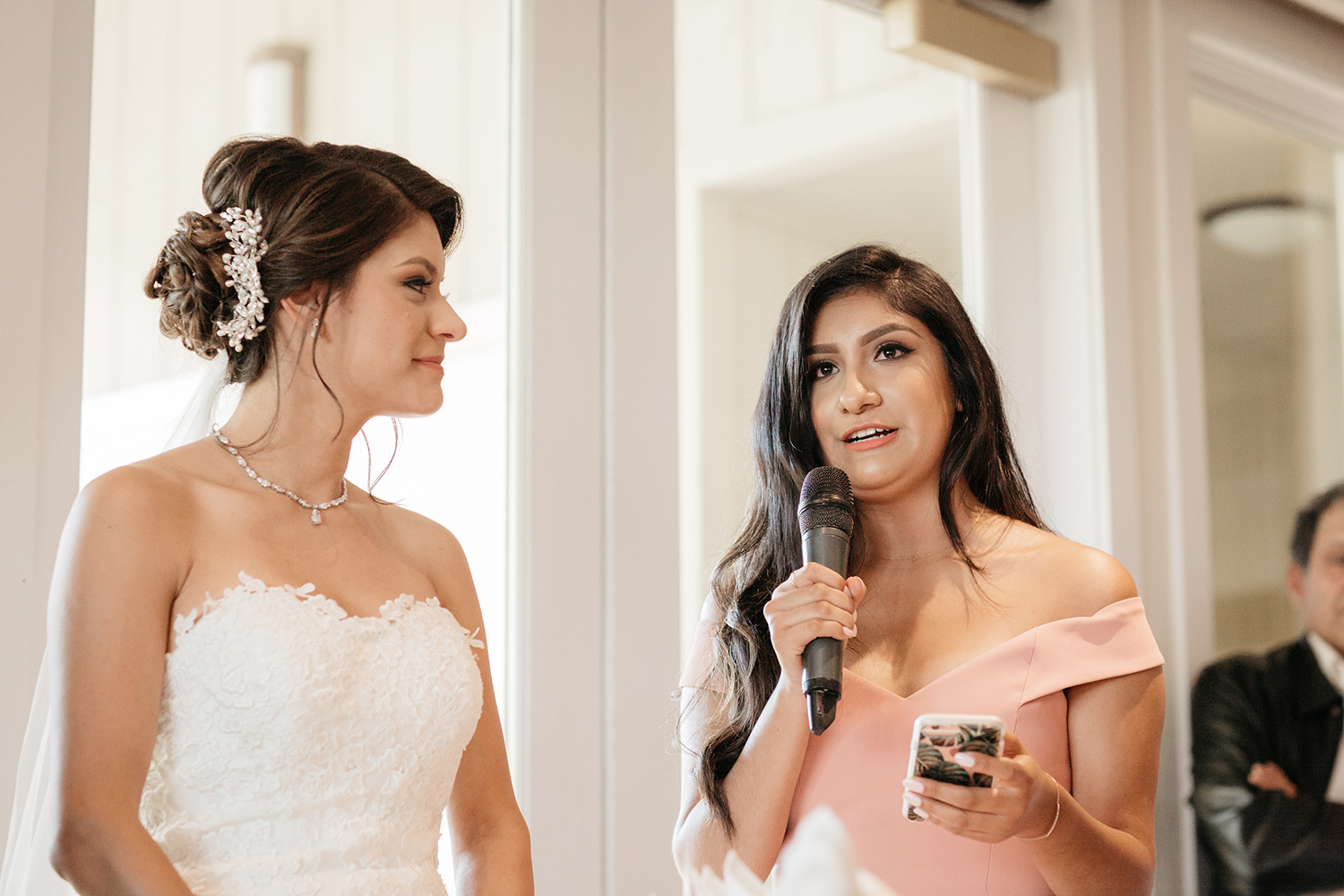 Maid of Honor and bride's sister giving a special speech at a wedding in Saratoga Country Club.