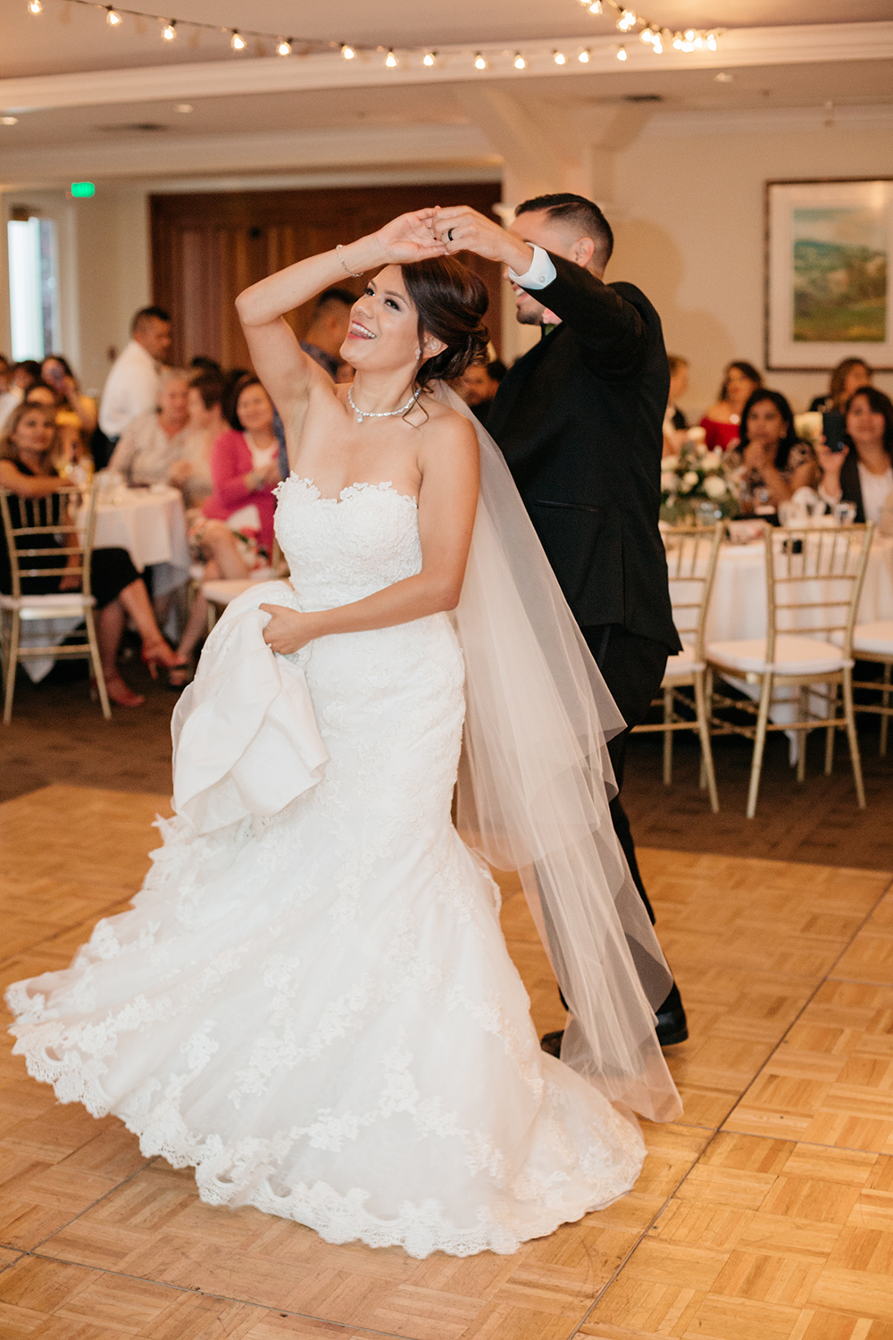 A bride and groom's fun first dance.