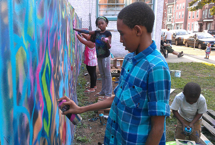 """Youth in Trenton enjoy a sunny day making art out on the streets at the Sage Coalition's """"Windows of Soul"""" three-day event."""