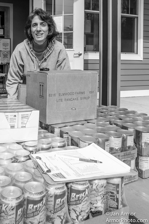 Restocking shelves at Food Pantry, Jonny Cake, Center