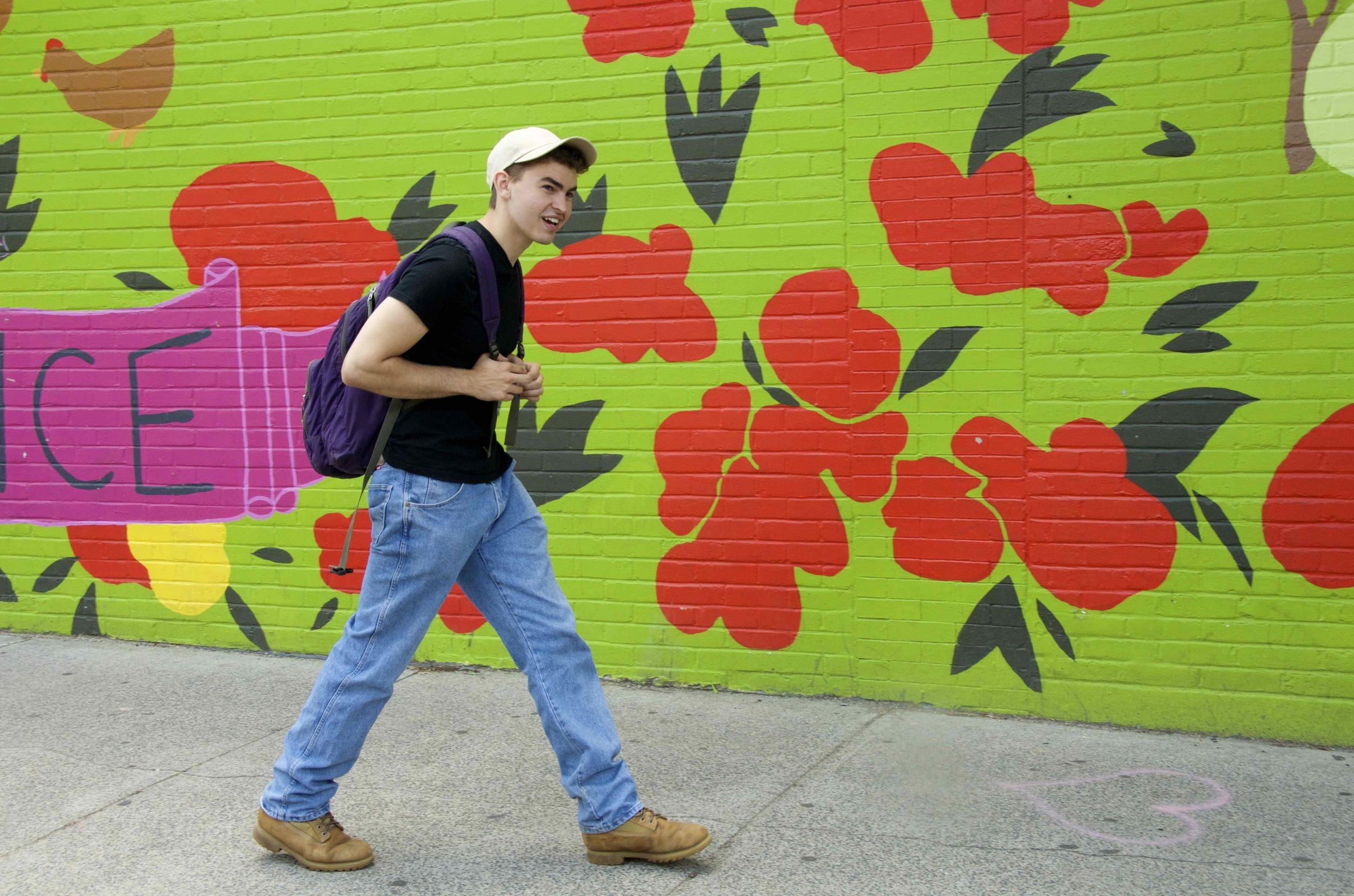 boy walking by flower@.jpg