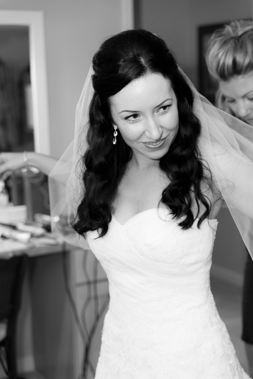 Bride getting into dress at Redwood Hills Garden, Sebastopol