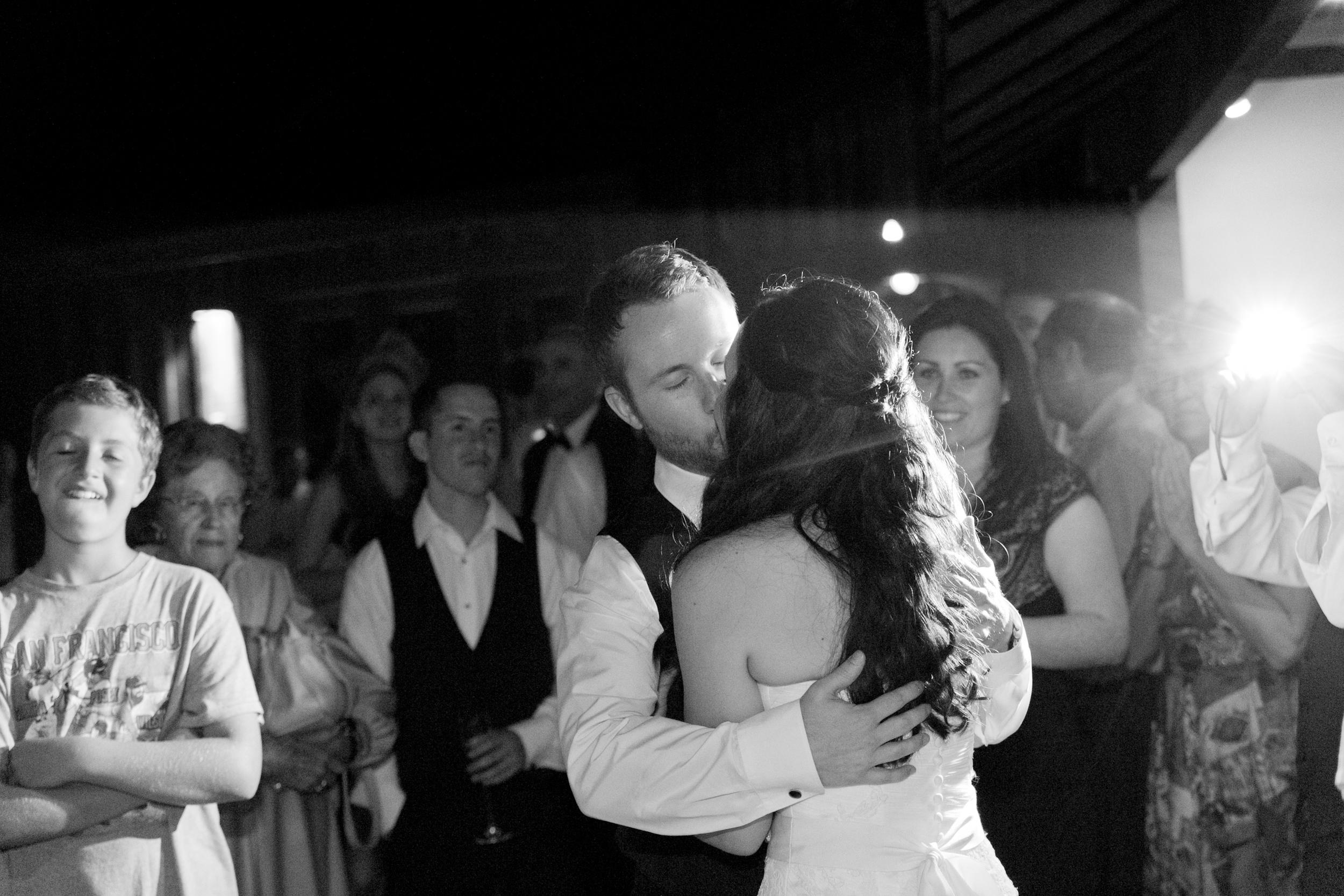 bride and groom kissing at redwood hills garden wedding