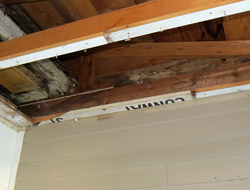 """Removal of porch ceiling reveals old road signs. This one once said """"Conway""""."""