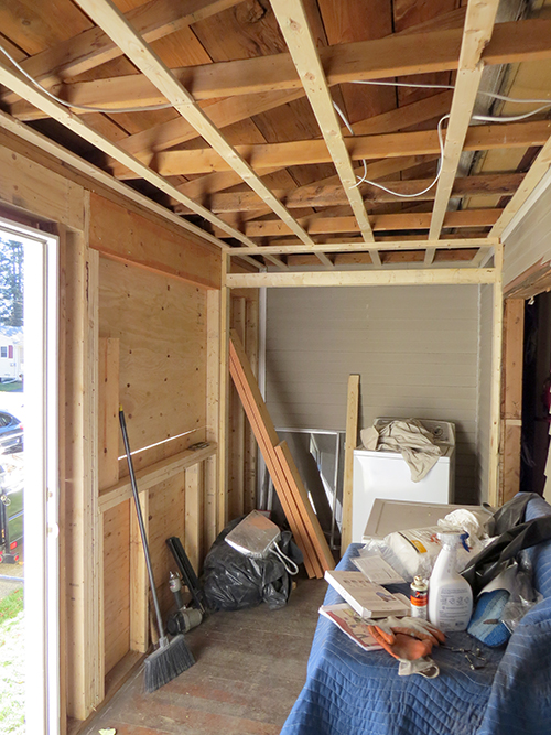 Porch with the laundry closet framed in and new ceiling joists added.