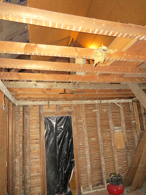 Kitchen ceiling removed looking up into the attic area.
