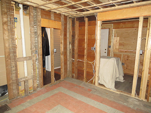 New entryway and old doorway, blocked off.