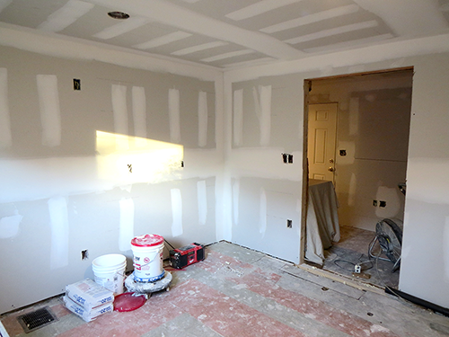 Kitchen, looking at the new entryway and walled off doorway.