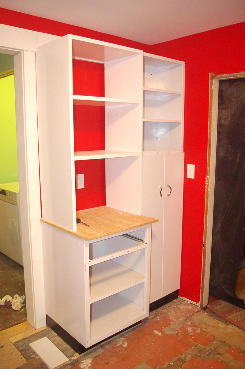 My cookbook shelf. This isn't quite attached yet, but eventually it will be flush with the broom closet.