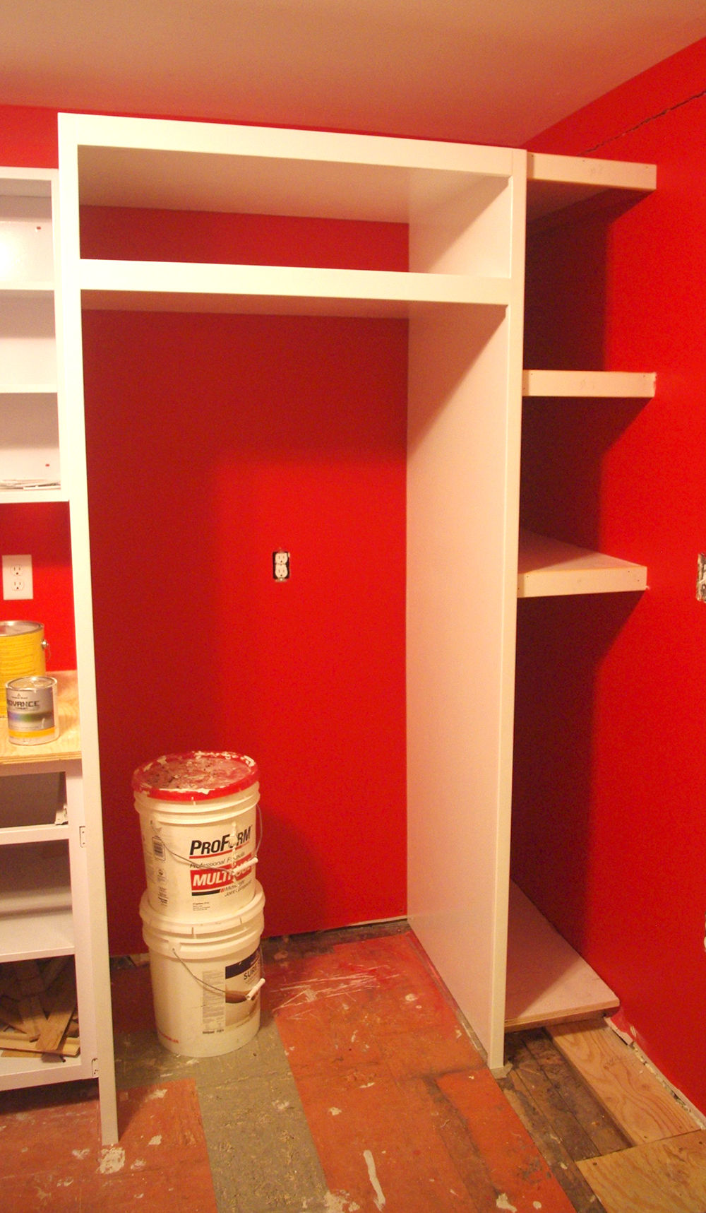 Our new fridge surround and shelves. The shelf above the fridge will eventually get doors and hardware to match the rest of the cabinetry.