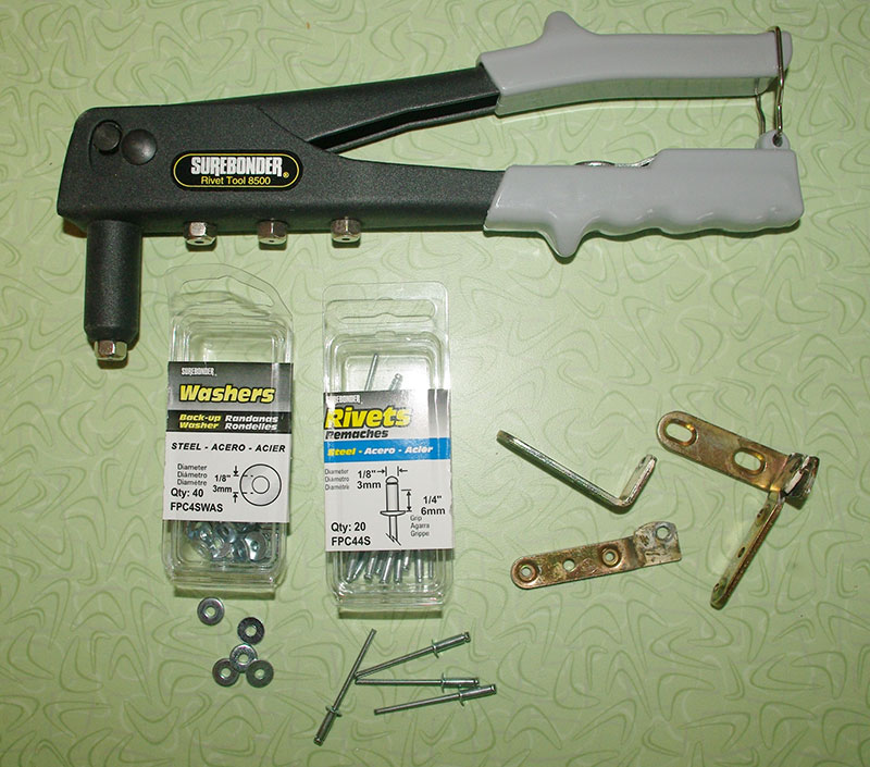 Tools required for fixing the hinges; Pop-rivet tool, washers and steel rivets. The broken hinges are shown in the lower-right.