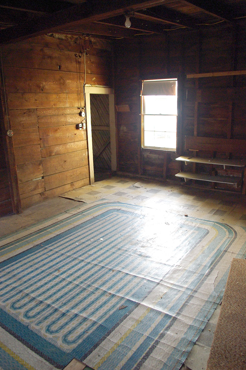 """View of the shed, from the house. Check out that awesome braided-rug-look sheet linoleum floor! This was Armstrong's """"Quaker Rug"""", circa 1954. Too damaged to save, so it was covered up with the new wood floor."""