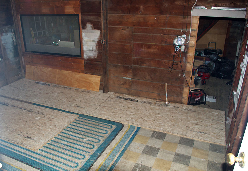 New sub-floor going down over the old linoleum. Someday, someone is going to find that treasure.