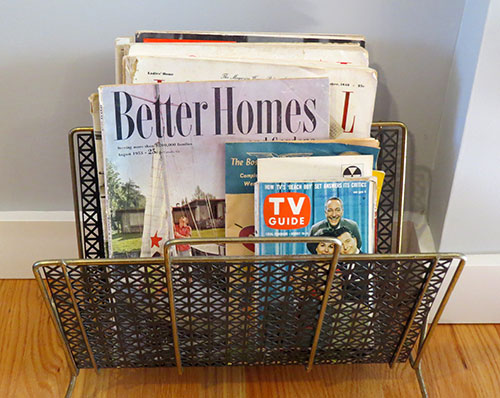 No mid-century living room would be complete without a magazine rack, filled with vintage magazines.
