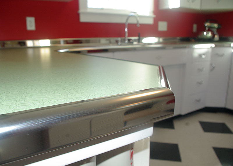 A close-up view of the metal trim replicating the Youngstown Kitchens trim.
