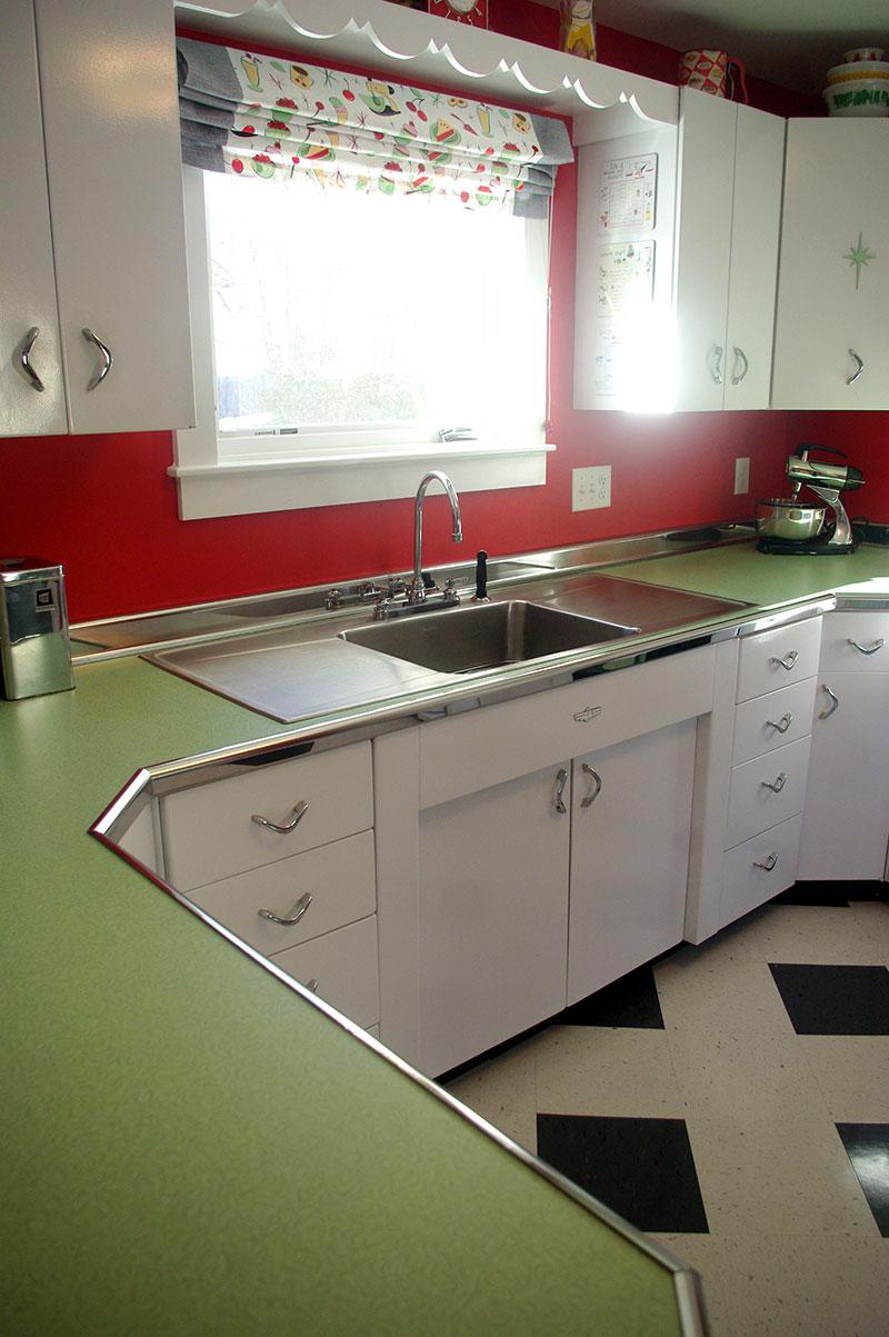 View of the Elkay Sink, Wilsonart countertop and metal trim