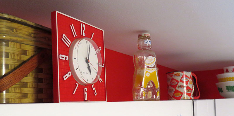 1950s Westinghouse Clock and other vintage decorations. The yellow bottle is an old Galaxy syrup bottle in the shape of a spaceman, from 1953.