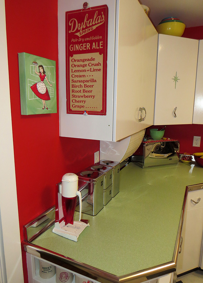 Our kitchen with the newly painted artwork in place.