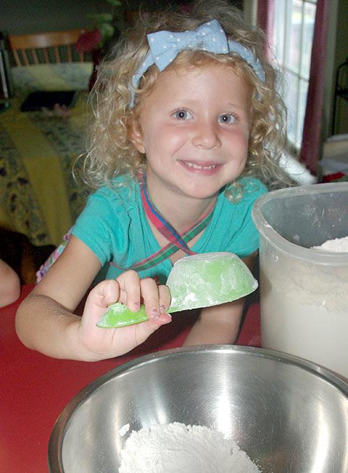 Julia adding flour to the mixture