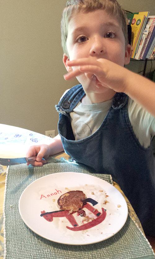 Caleb making short work of his dino pancake