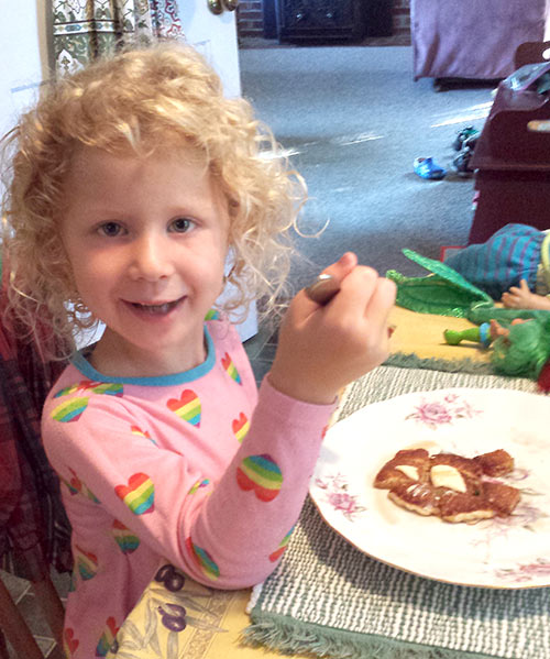Julia enjoying her pancake