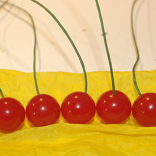 The cherries for the brooch, with the new stems glued in place