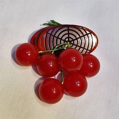 An example of one of the cherry log brooches for sale  online .