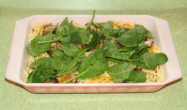 My added vegetable layer of spinach and mushrooms which replaced the meat.