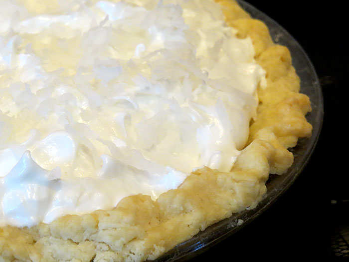 The meringue topping sprinkled with coconut
