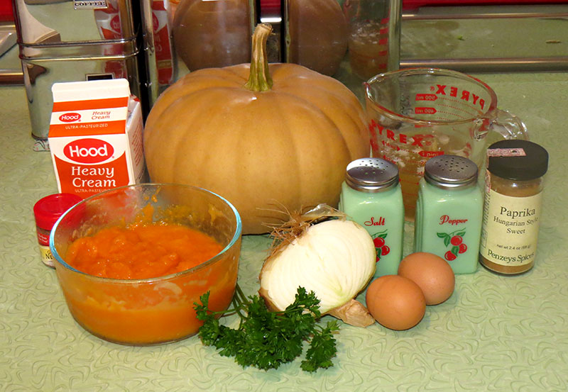 The ingredients for cream of pumpkin soup. That is a long island cheese pumpkin is in the background.