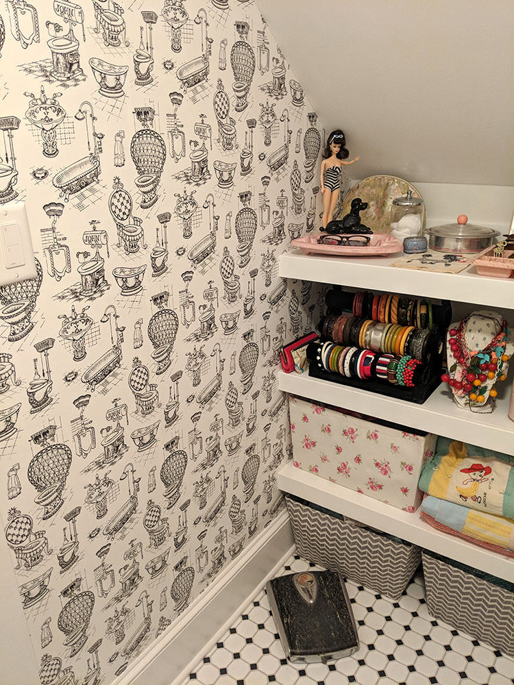 The wallpapered wall. Papering around the shelves was not the most fun task in the world.