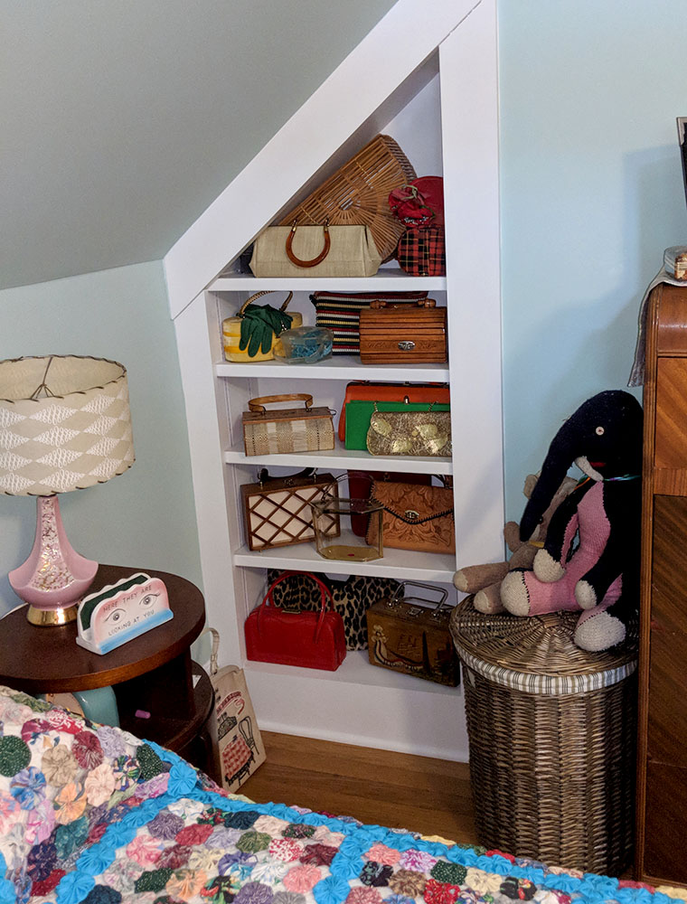 My vintage purse collection on the new shelves. The elephant in the corner was knitted for me, by my grandmother, when I was little.