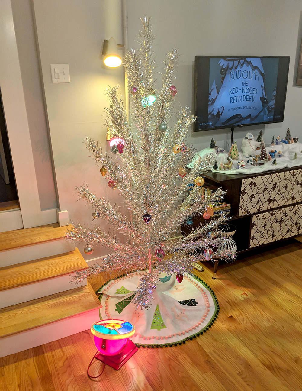 Our living room with sparkly aluminum Christmas tree