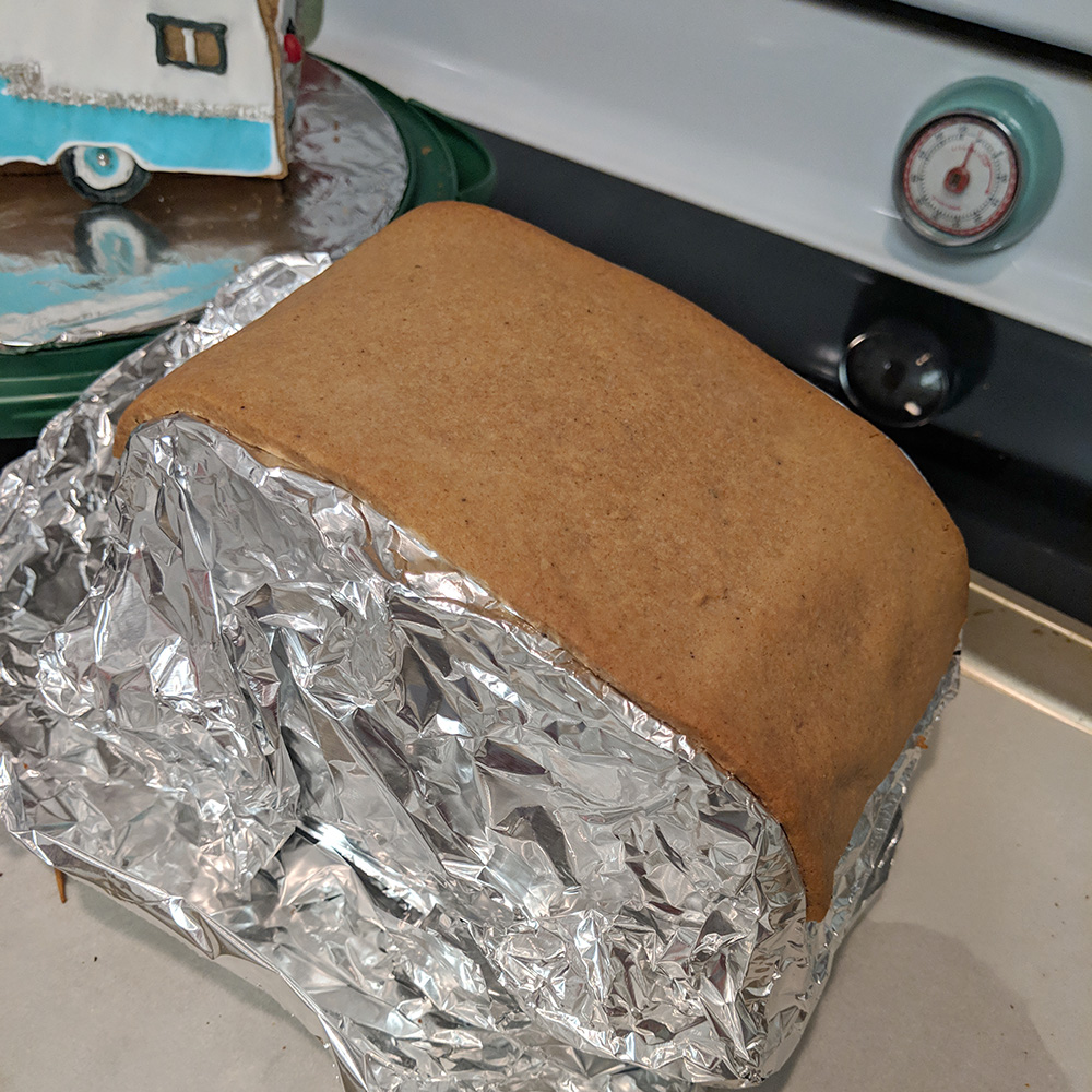 The aluminum foil-covered frame with the roof piece.