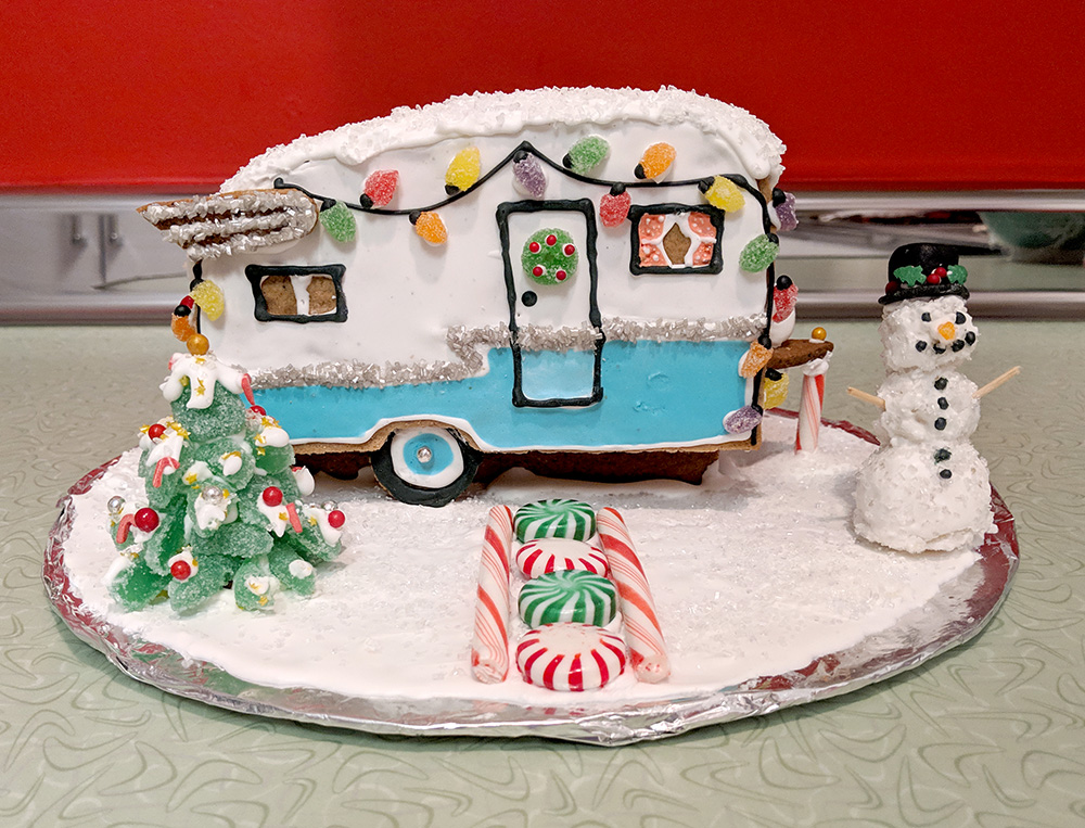 The finished camper with candy tree and walkway and marzipan snowman