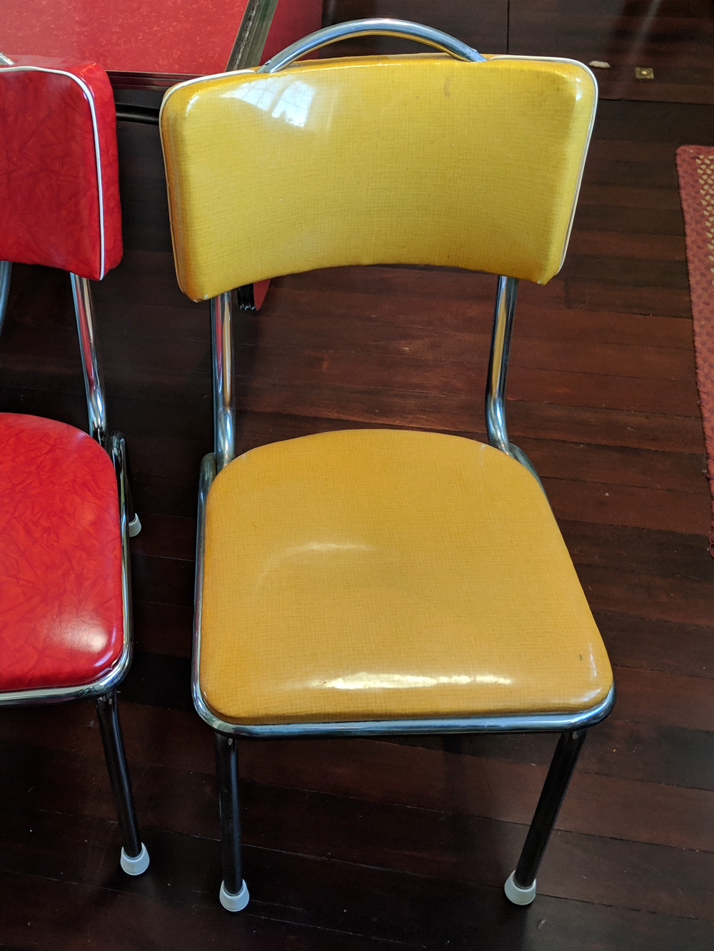 One of the chairs with the original vinyl