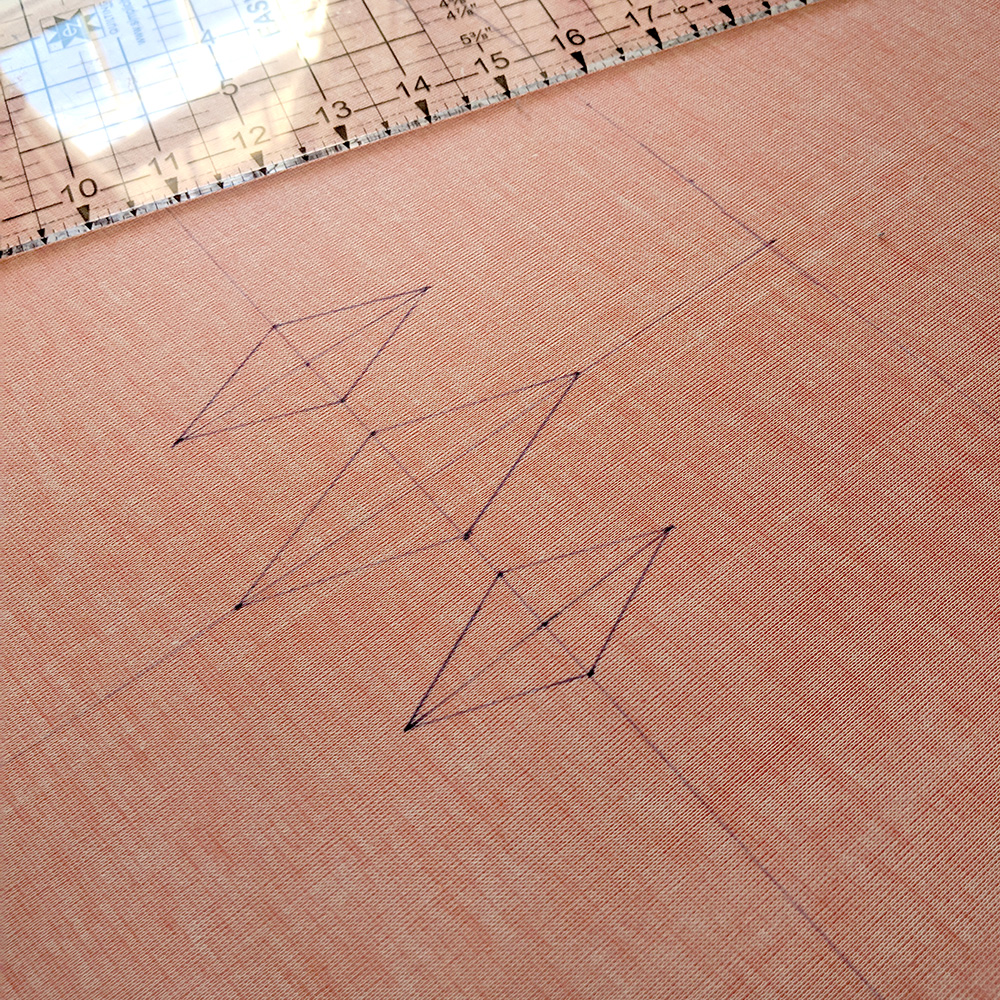 The back of the fabric with the diamond pattnern drawn out.