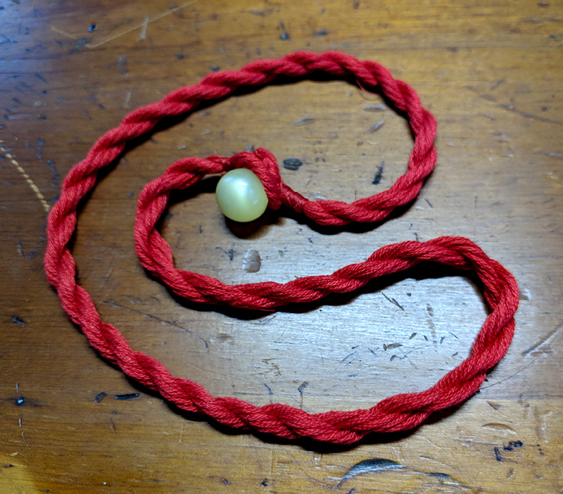 The finished cord with ball button clasp